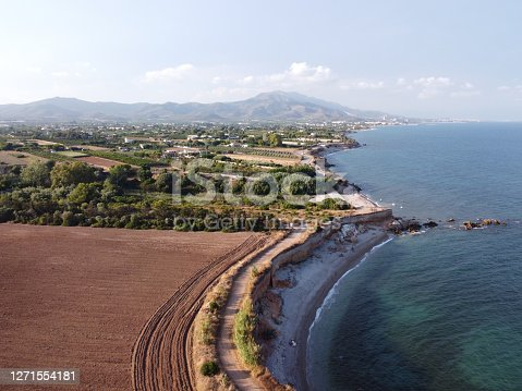 Stunning Aerial view of the coastline of Jardi de Sol de Riu and Senia river delta in Vinaros, Spain