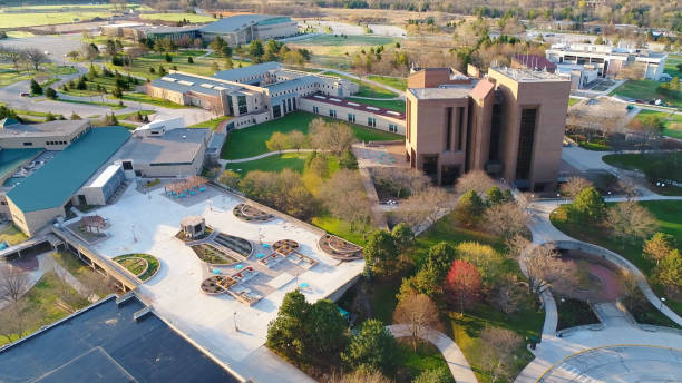 stunning aerial view of the university of wisconsin green bay campus at sunrise in springtime. - green bay wisconsin stock photos and pictures