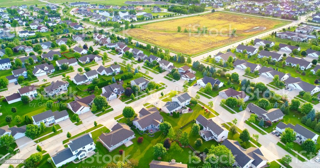 Stunning aerial view of vast suburban neighborhoods with field stock photo