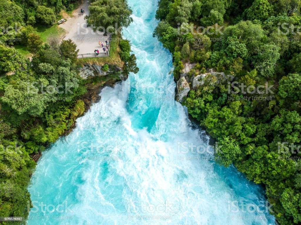 Stunning aerial wide angle drone view of Huka Falls waterfall in Wairakei near Lake Taupo in New Zealand. The waterfall is part of the Waikato River and is a major tourist attraction. stock photo