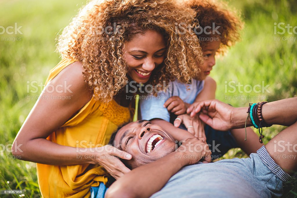 Stunning African-American family relaxing with eachother while l stock photo