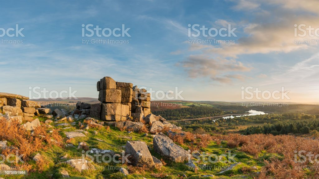 Stunning Autumn sunset landscape image of view from Leather Tor towards Burrator Reservoir in Dartmoor National Park - Royalty-free Atmospheric Mood Stock Photo