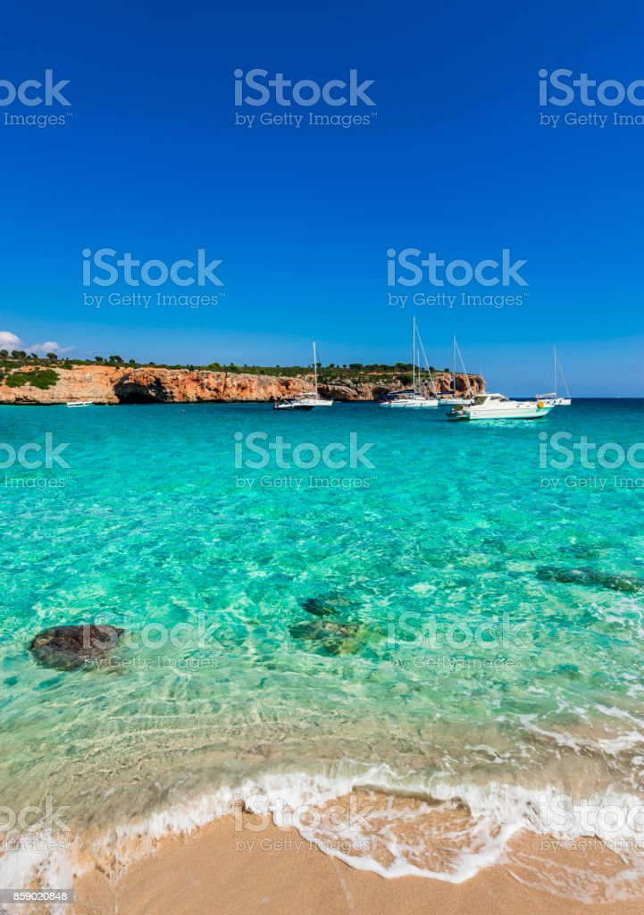 Stunning bay with turquoise sea water and sailing boats, Cala Varques Majorca, Spain Balearic Islands stock photo