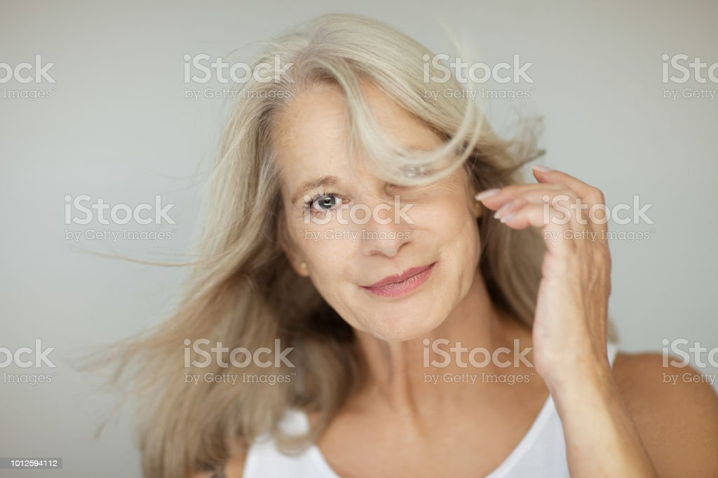stunning beautiful and self confident best aged woman with grey hair royalty-free stock photo