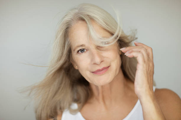 stunning beautiful and self confident best aged woman with grey hair stock photo