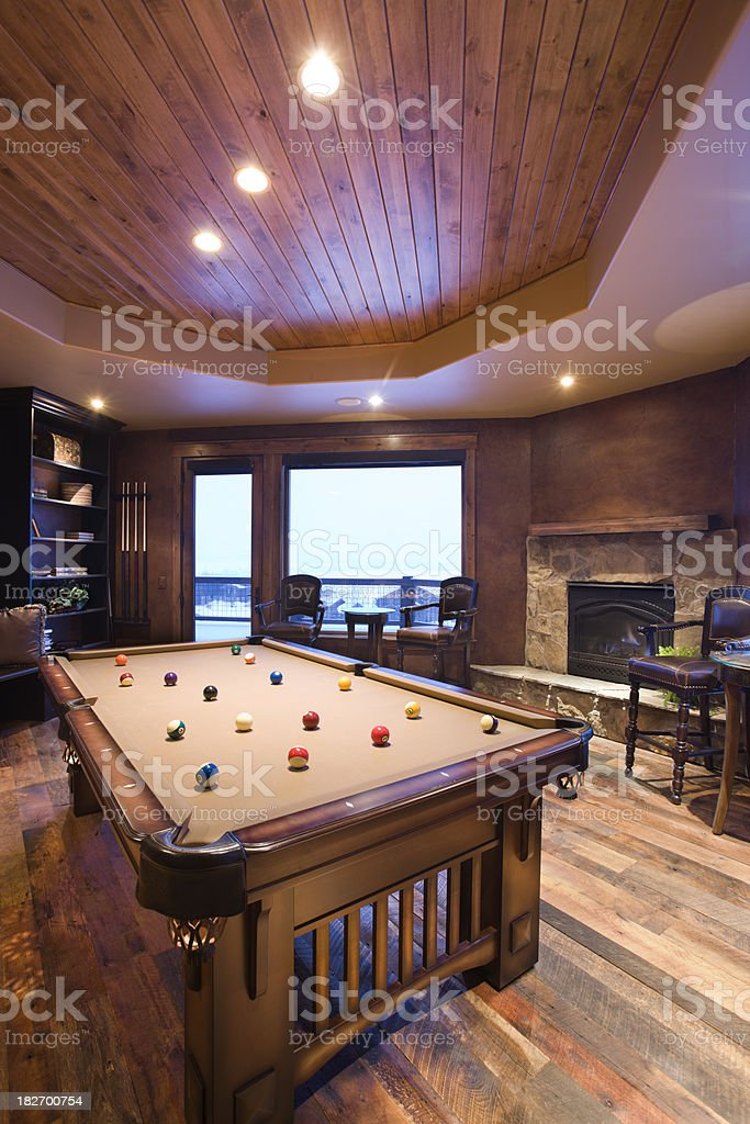 Stunning billiards room with Western mountain lodge decor. stock photo