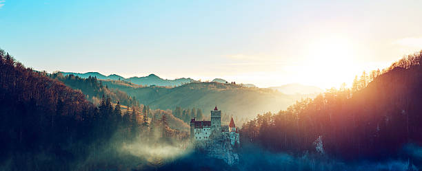 stunning bran castle at sunset - romania stock photos and pictures