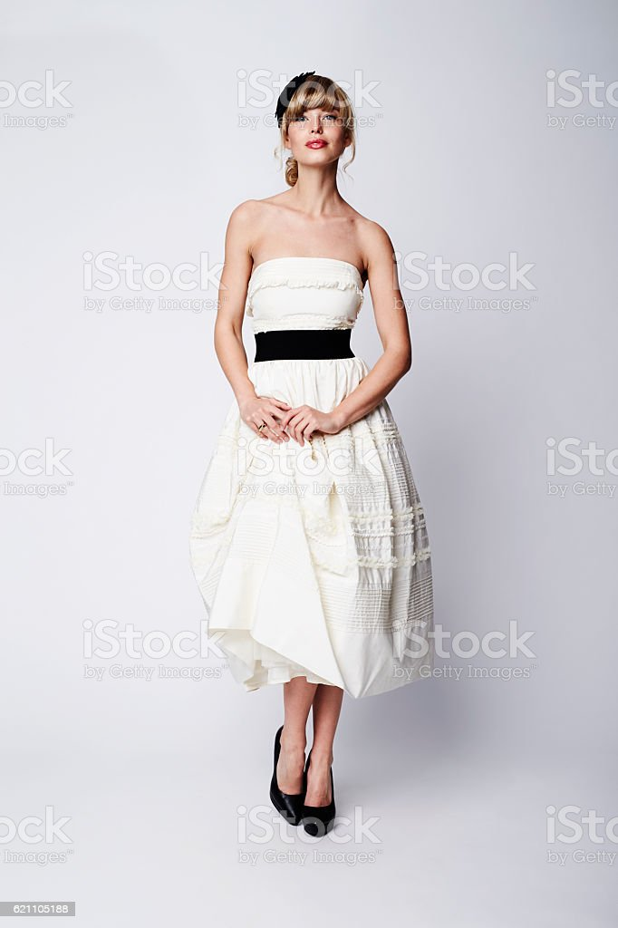 Stunning bride in white studio, portrait stock photo