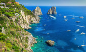 Stunning Capri island, beach and Faraglioni cliffs, Italy, Europe