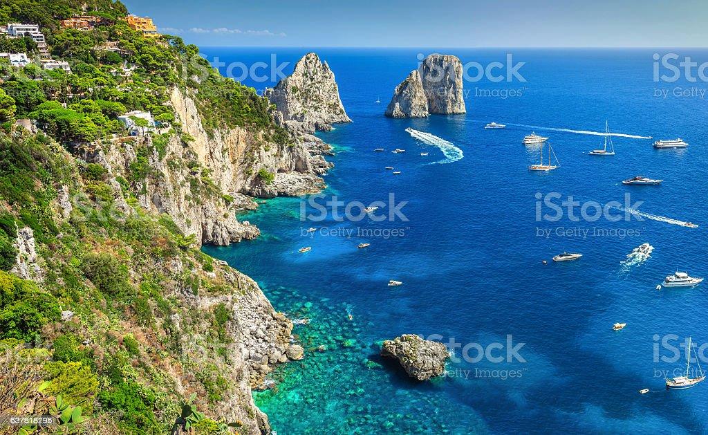 Stunning Capri island, beach and Faraglioni cliffs, Italy, Europe stock photo
