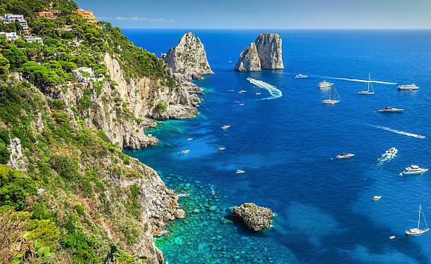 Stunning Capri island, beach and Faraglioni cliffs, Italy, Europe stock photo