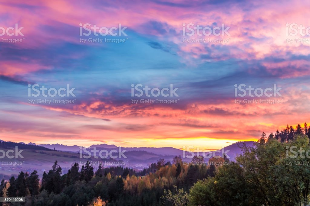 Stunning castle by the lake at sunset in autumn stock photo