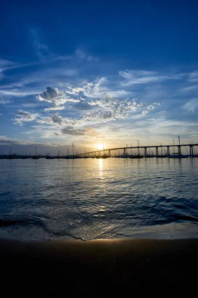 stunning cloudscape over the Coronado Bay Bridge during sunrise stock photo