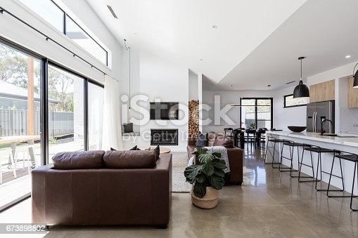 istock Stunning contemporary open plan spacious living and dining room 673898802
