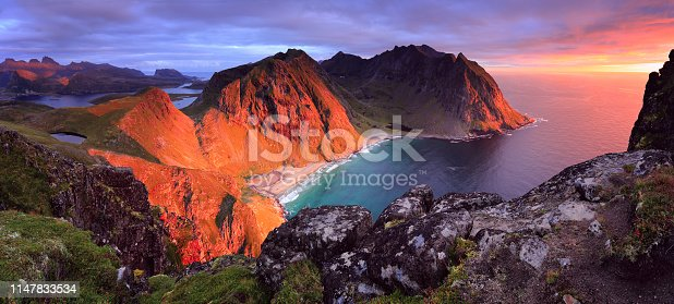 istock Stunning dramatic view of Kvalvika Beach at sunset in Norway, Lofoten islands. 1147833534