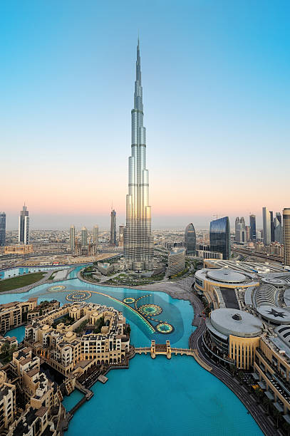 Stunning dubai This is a very rare capture of burj khalifa and downtown dubai city in the first light morning with the fountain lights. burj khalifa stock pictures, royalty-free photos & images