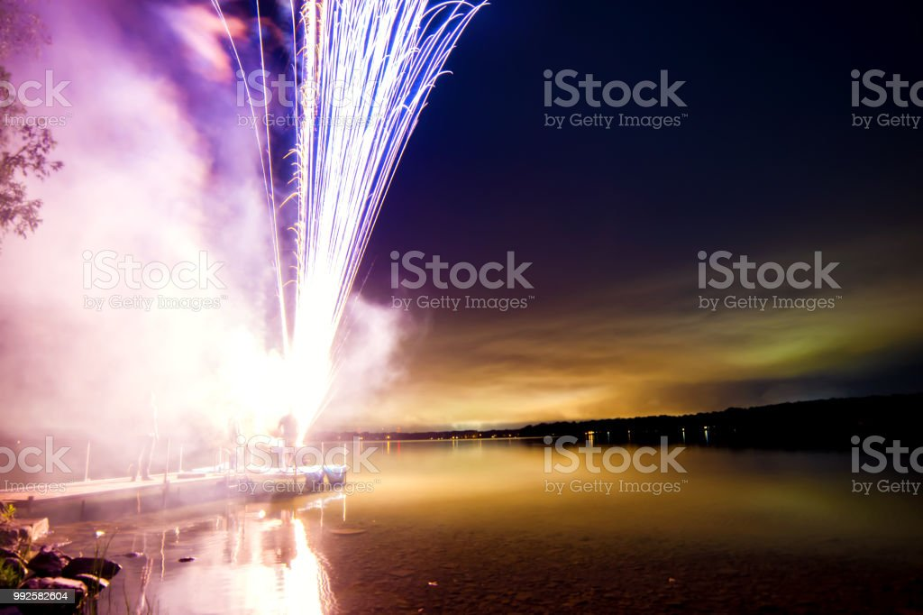 Stunning fireworks on dock  Clearwater  lake stock photo