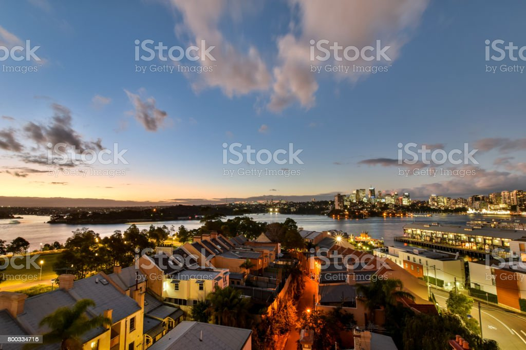 Stunning HDR night shot of the night skyline in Sydney, New South Wales, Australia. Beautiful view of North Sydney, Millers Point, Walsh Bay and the Barangaroo reserve. Shortly after sunset. stock photo