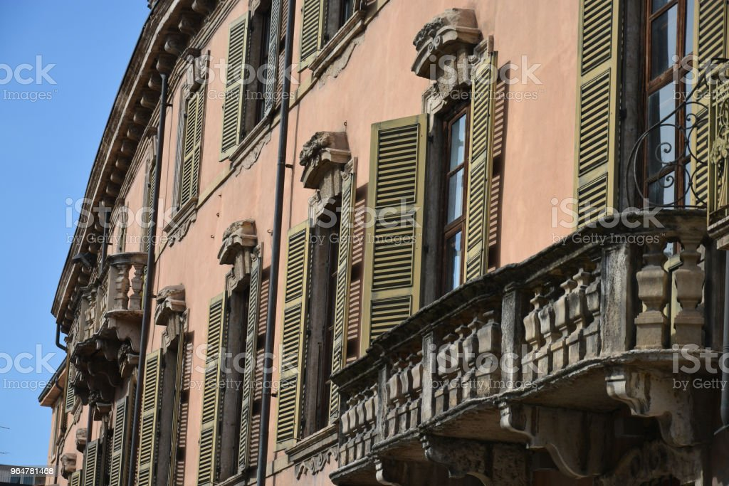 Stunning homes and architecture with the ancient balconies of the beautiful Verona royalty-free stock photo