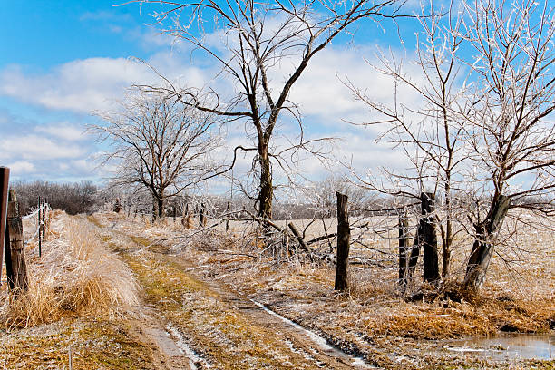 Stunning Ice-Encased Landscape With Fence and Road stock photo