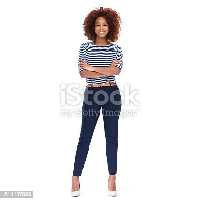 Full-length portrait of a beautiful young woman standing against a white background