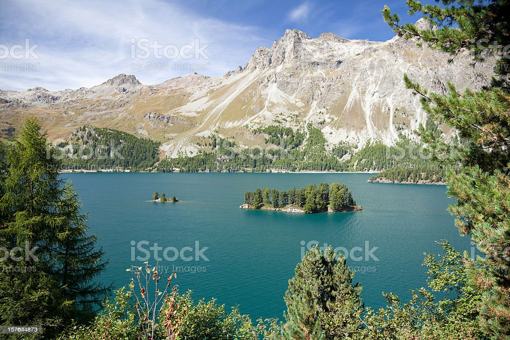Stunning Lake Sils with Islands and Piz Lagrev, Engadine, Switzerland stock photo