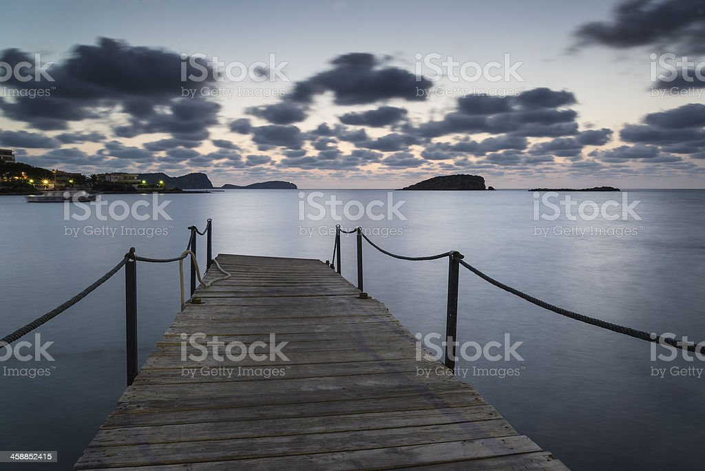 Stunning landscape dawn sunrise over jetty in Mediterranean Sea royalty-free stock photo