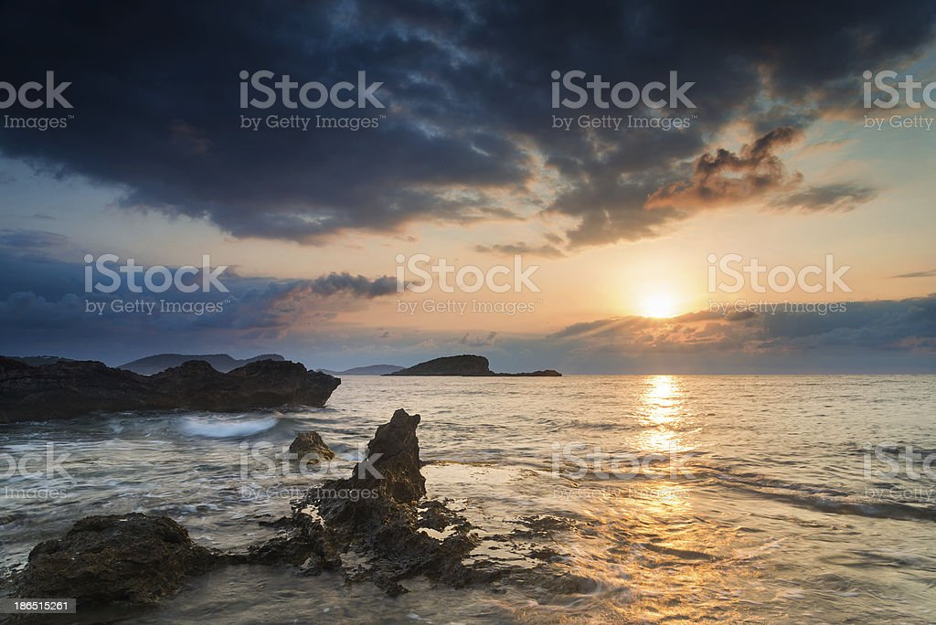 Stunning landscape dawn sunrise with rocky coastline in Mediterranean Sea royalty-free stock photo