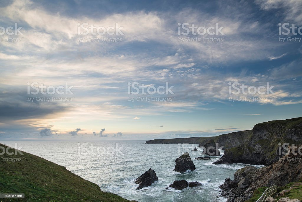 Stunning landscape image of Bedruthan Steps on Cornwall coast in stock photo