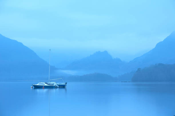 Stunning landscape image of misty Derwentwater in Lake District on cold Winter morning stock photo
