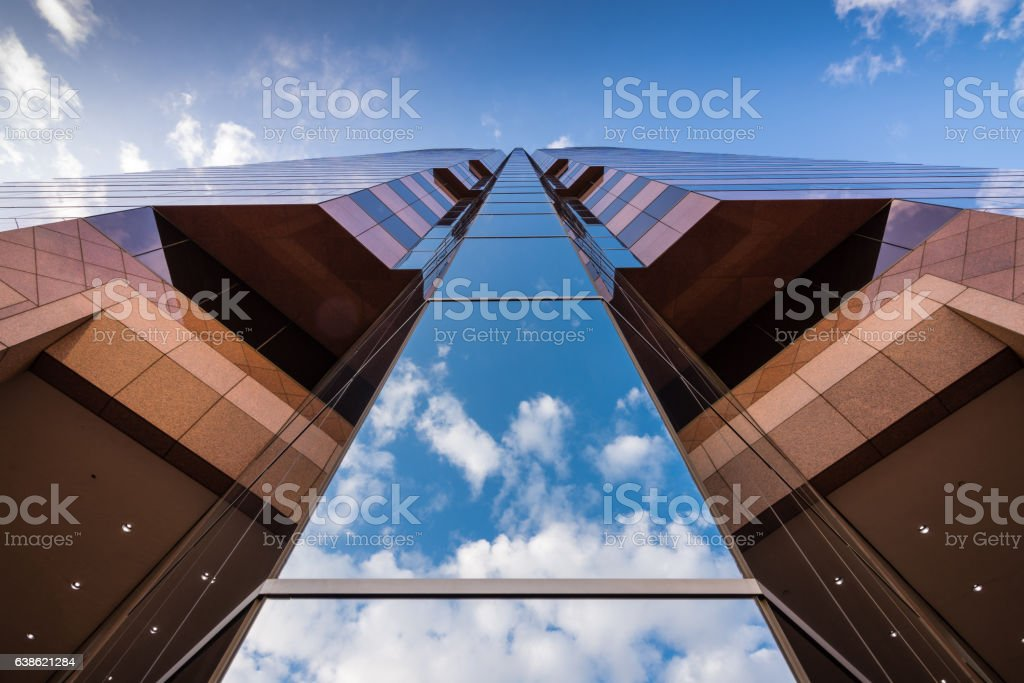 Stunning low angles of office buildings against blue sky stock photo