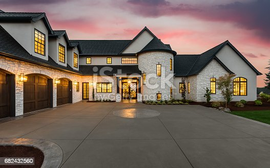 istock Stunning luxury home exterior at sunset 682432560