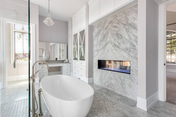 stunning master bathroom interior in luxury home with bathtub, shower, and fireplace. - bathroom renovation stock photos and pictures