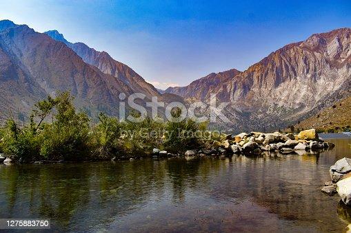 Stunning beautiful colorful granite rock mountain range plunging clear pristine alpine lake