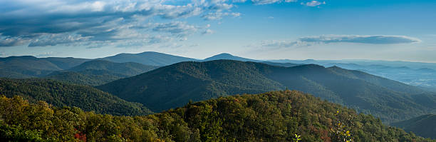 A stunning panorama of Blue Ridge Mountains A partially grey threatening sky casts darkness over the Blue Ridge Mountains and valleys, an indicator rain may soon fall. Photo taken on the Skyline Drive in Shenandoah National Park.  appalachia stock pictures, royalty-free photos & images