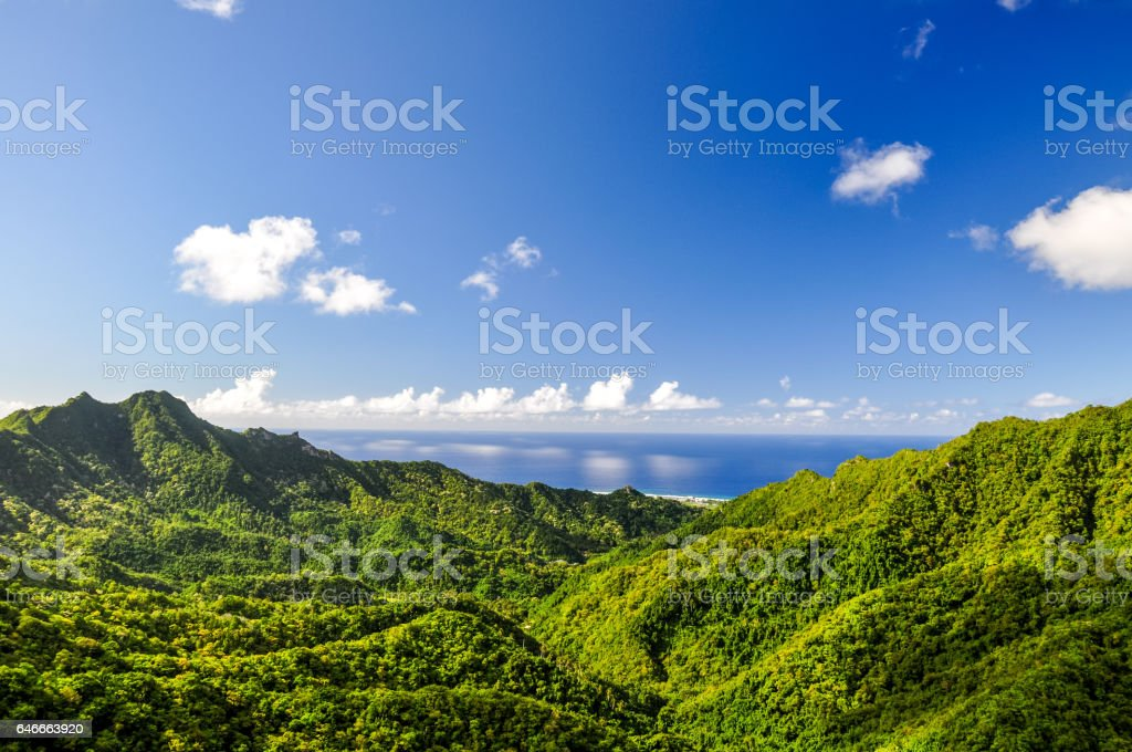 Stunning panorama view from a place called 'The Needle' on Rarotonga, the main island of the Cook Islands in the South Pacific. The viewpoint can be reached through hiking the 'Cross Island Walk'. stock photo