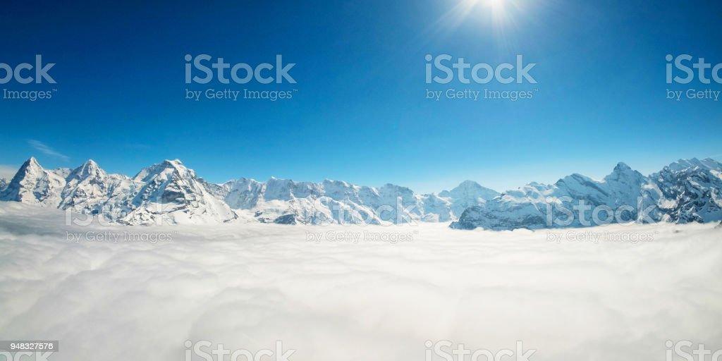 Stunning Panoramic view Snow moutain of the Swiss Skyline from Piz Gloria Schilthorn, Switzerland stock photo