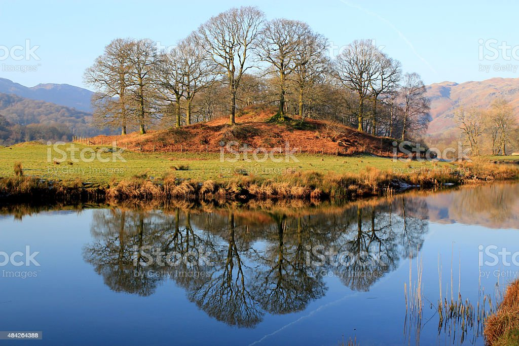 Stunning reflection of trees in the Lake District, Cumbria, UK stock photo