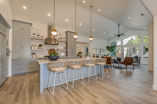 Vaulted ceiling allow pendant lights give huge open feel to custom kitchen and home