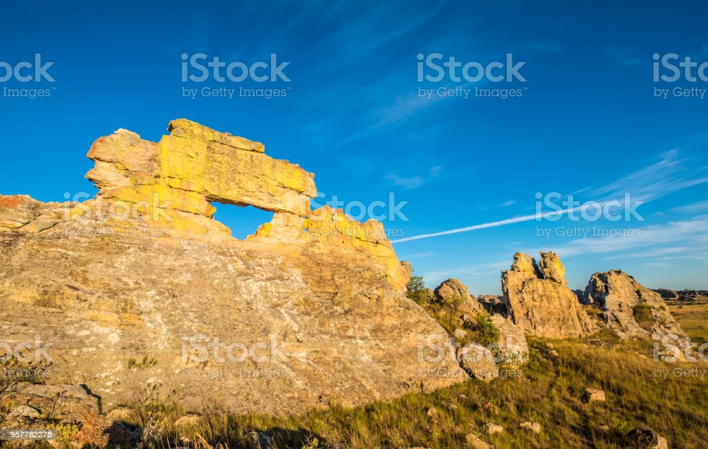 Stunning rock formations, Isalo National Park, Ihorombe region, Madagascar. Known for its wide variety of terrain, including sandstone formations, deep canyons, a palm-lined oases, and grassland, and rich wildlife stock photo