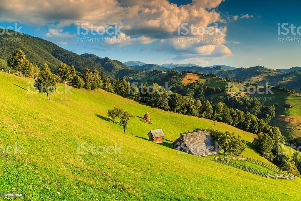 Stunning rural landscape near Bran,Transylvania,Romania,Europe Summer alpine landscape with green fields and valleys,Bran,Transylvania,Romania,Europe 2015 Stock Photo