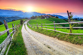 Spring alpine landscape with green fields and majestic sunset,Bran,Transylvania,Romania,Europe