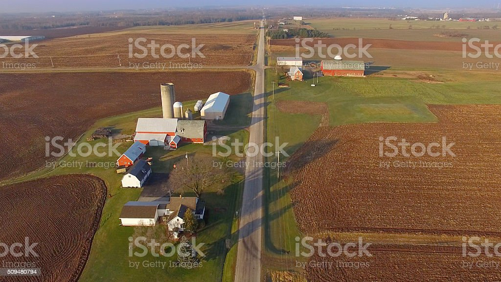 Stunning Rural Sunrise Landscape with Farms and Cultivated Fields stock photo