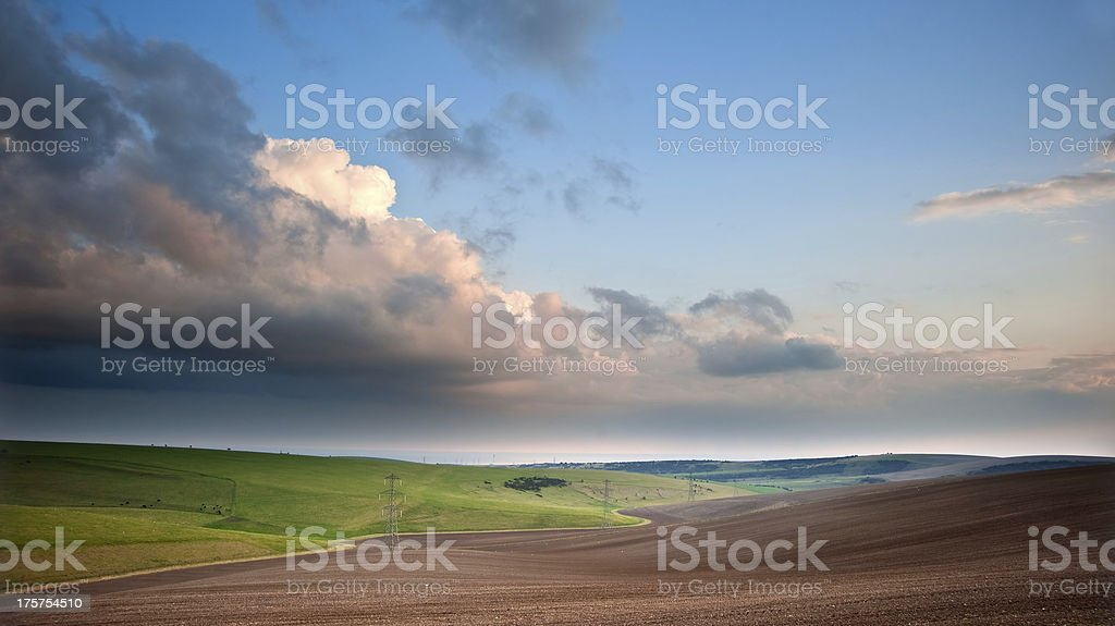 Stunning scene across countryside landscape with beautiful cloud formations royalty-free stock photo