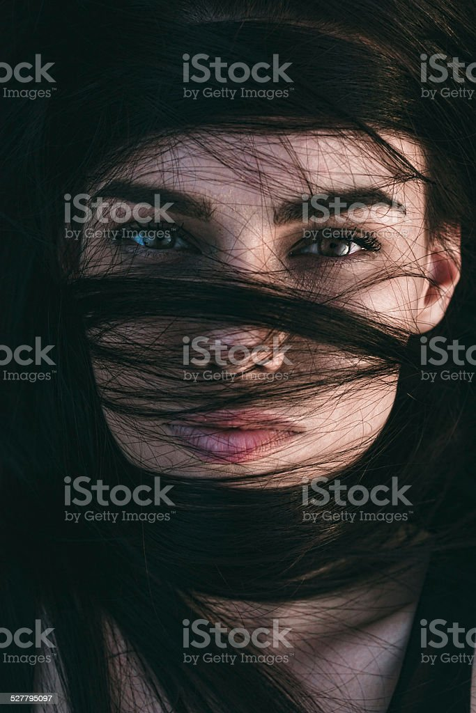 Stunning sensual woman with lustrous eyes stock photo