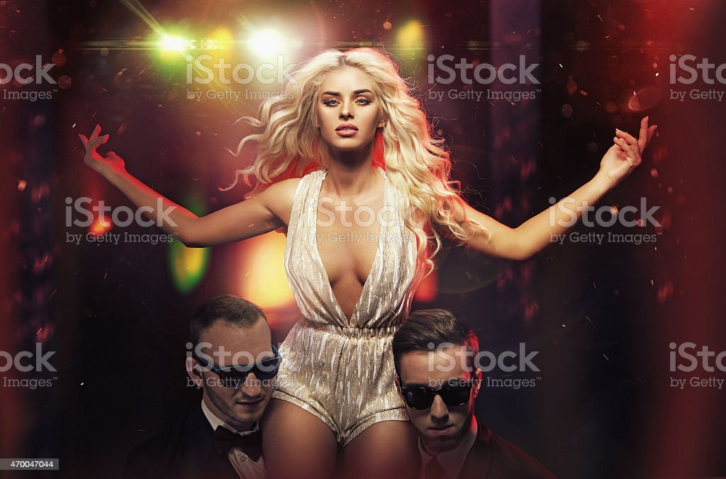 Stunning star protected by the bodyguards stock photo