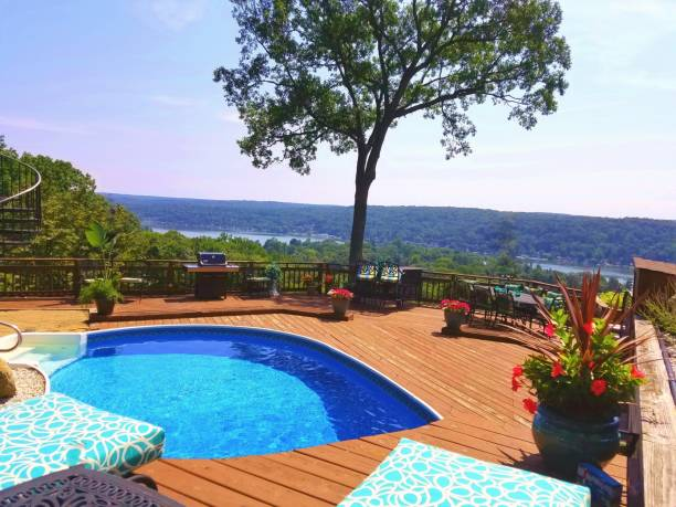 Stunning Summertime Rustic Poolside Setting With Panoramic Water Views in Background stock photo