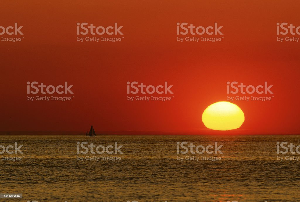Stunning Sunset and Sailboat royalty-free stock photo