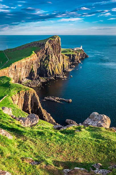 Stunning sunset at the Neist point lighthouse, Scotland Stunning sunset at the Neist point lighthouse, Scotland isle of skye stock pictures, royalty-free photos & images