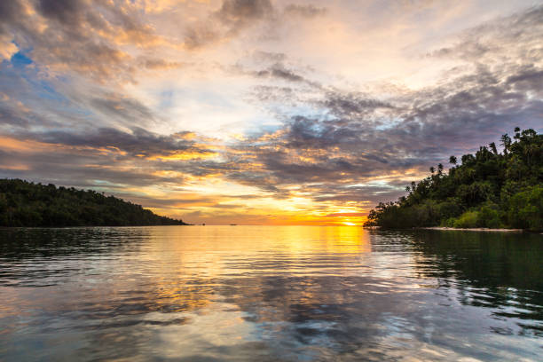 Stunning sunset in the Togian (or Togean) islands in Sulawesi, Indonesia Stunning sunset in the Togian (or Togean) islands in Sulawesi, a remote corner of Indonesia still untouched by pollution in the Celebes sea. sulawesi stock pictures, royalty-free photos & images